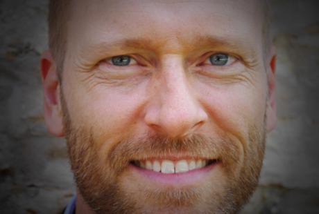Closeup headshot of Forrest Pierce, Composer